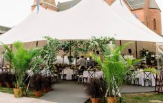 a luxury tent set up outdoors near a brick building