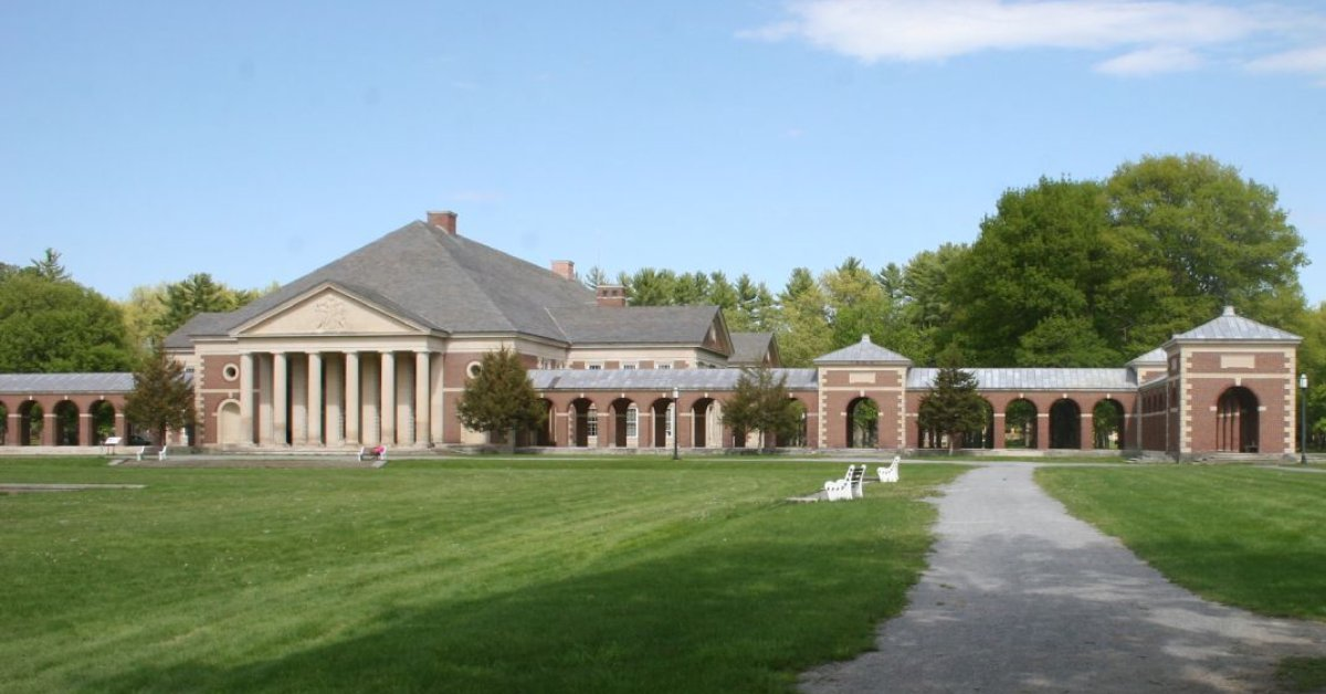 large brick building in a park