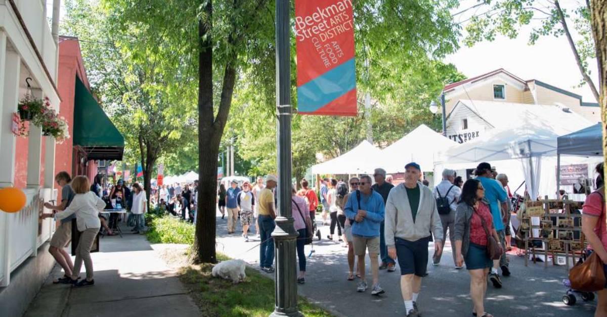 people at an outdoor art fair