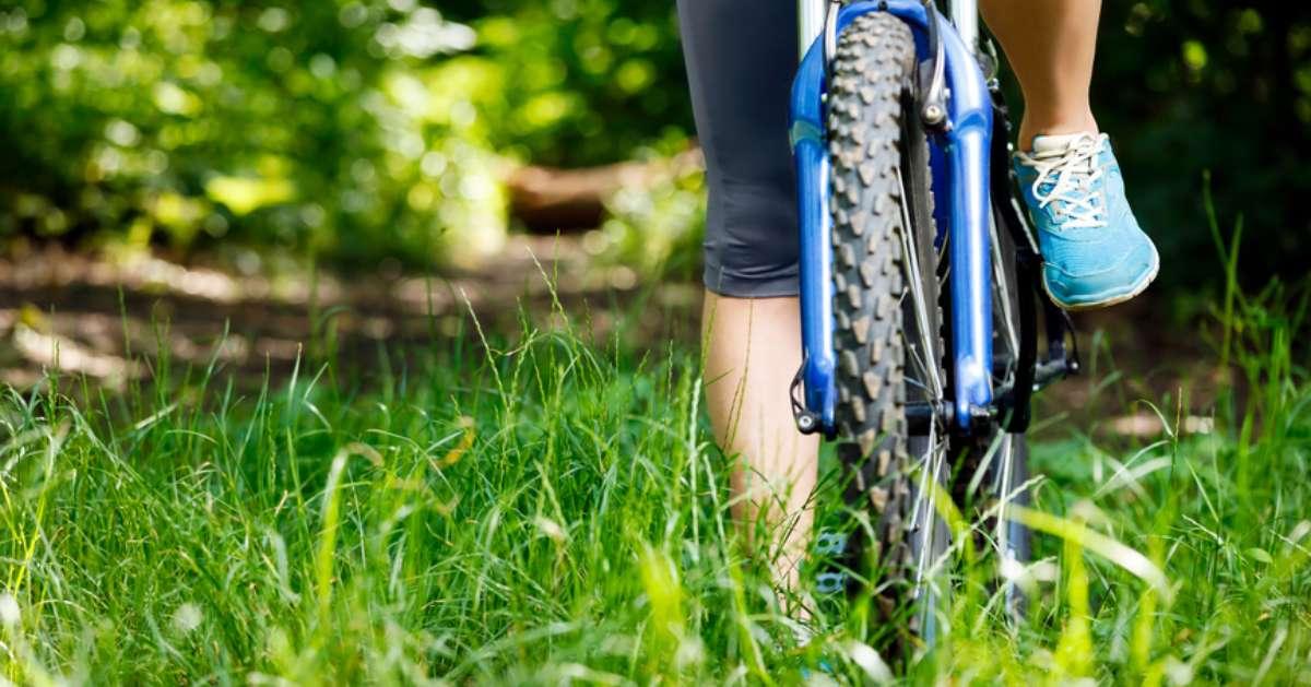 person biking on grass