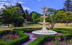 a fountain in a scenic park