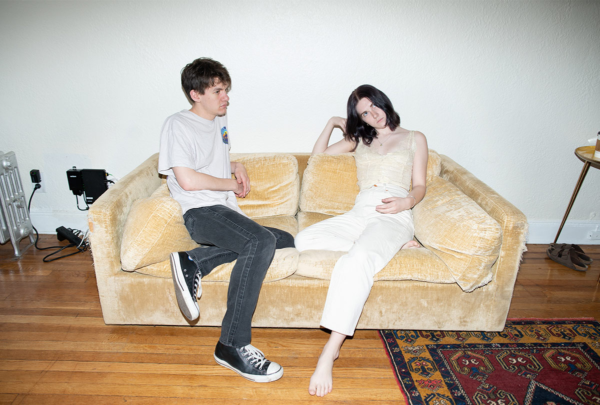 two people sitting on a couch