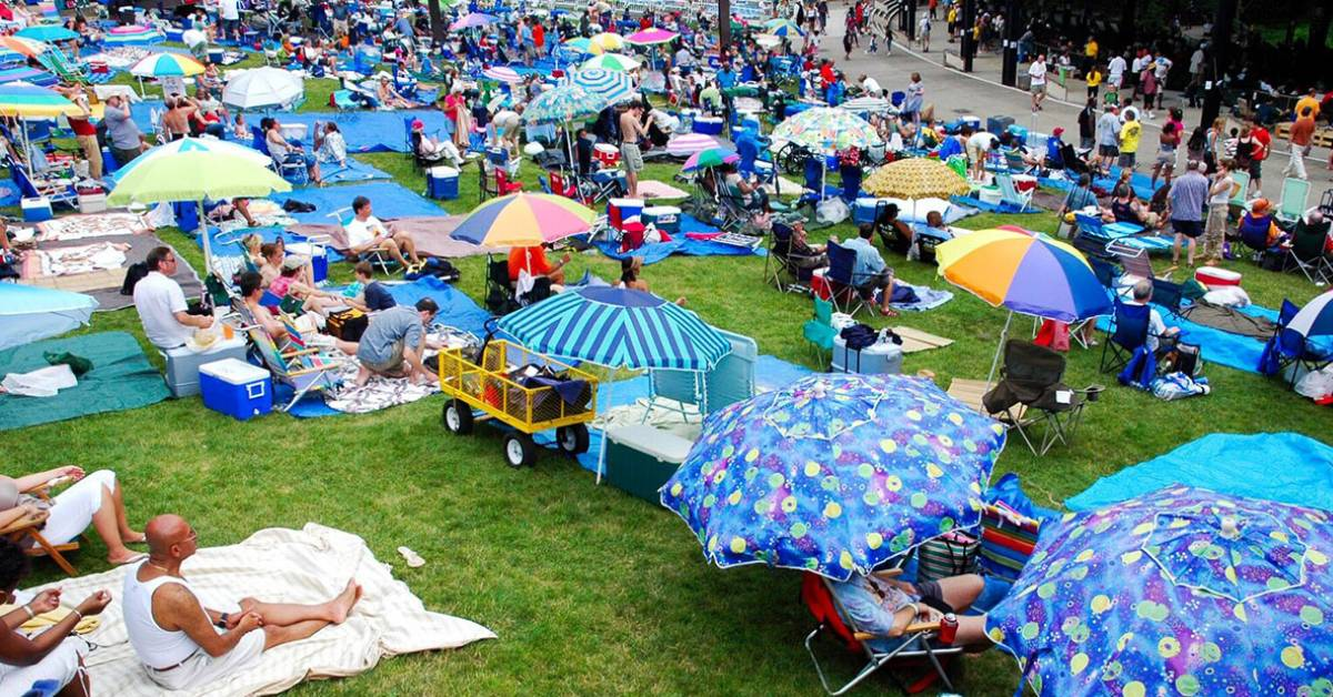 people on a lawn at a concert hall