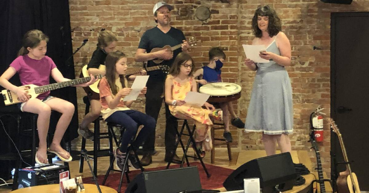 kids and adults on small music stage